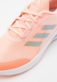 adidas Performance - FORTARUN KIDS NEXT CLOUDFOAM RUNNING SHOES UNISEX - Neutral running shoes - haze coral/footwear white/grey two - 5