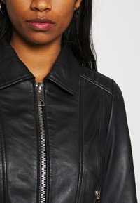 Vero Moda - VMMAPEL SHORT JACKET - Leather jacket - black - 3