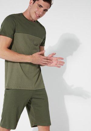 Pyjama set - green helmet st.small stripes