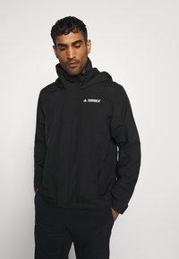 adidas Performance - FOUNDATION RAIN.RDY HIKING JACKET - Hardshell jacket - black - 0