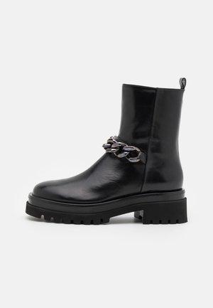 GOLVA - Platform ankle boots - black