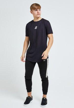 LONDON ERUPT - Pantalones deportivos - black & cream