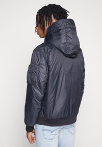 Nike Sportswear - M NSW HE WR JKT HD REV INSLTD - Kurtka przejściowa - black - 4