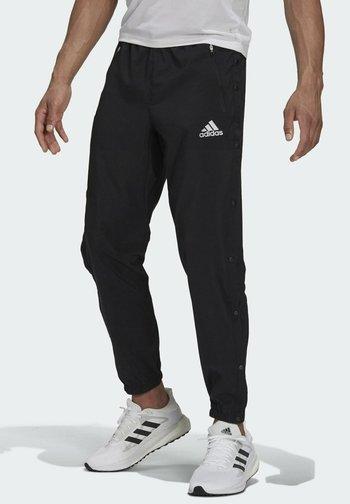FAST SNAP PANT RUNNING SUPERNOVA PRIMEGREEN PANTS - Pantaloni sportivi - black