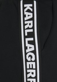 KARL LAGERFELD - LOGO TAPE PANTS - Trousers - black - 5
