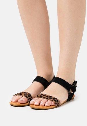 RYNELL - Sandals - black/tan