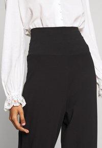 CALANDO - COMFY STRAIGHT LEG TROUSERS - Trousers - black - 4