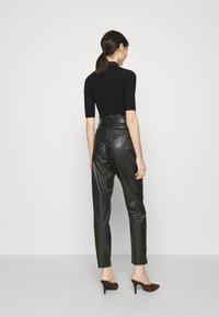 Vero Moda - VMEVA PAPERBAG ANKLE PANTS - Trousers - black - 2