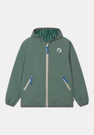 VALAS REVERSIBLE UNISEX - Waterproof jacket - trellis/charcoal