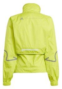adidas by Stella McCartney - ADIDAS BY STELLA MCCARTNEY TRUEPACE TWO-IN-ONE JACKET - Training jacket - yellow - 1