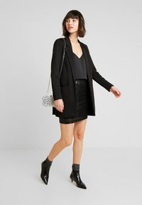 Gina Tricot - EXCLUSIVE HOLLY GLITTER SKIRT - Minisukně - black - 1
