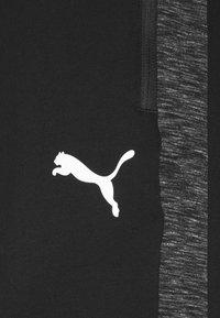 Puma - EVOSTRIPE PANTS - Pantalon de survêtement - black - 4