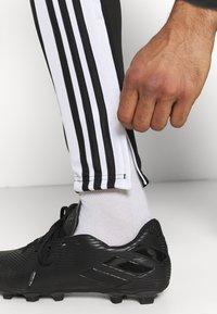 adidas Performance - SQUAD - Tracksuit bottoms - black/white - 3