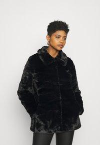 Vero Moda - VMVALLIRIO JACKET - Classic coat - black - 0
