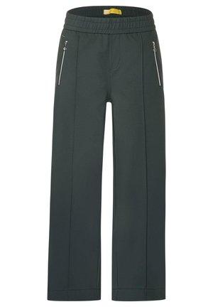 MIT ZIPPERN - Trousers - grün
