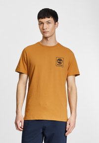 Timberland - Print T-shirt - wheat boot/black - 0