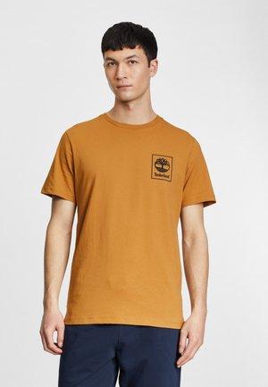 Print T-shirt - wheat boot/black