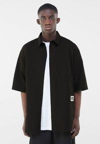 Bershka - Shirt - black - 0