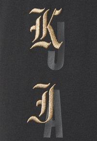 Nike Performance - T-shirt med print - black - 6