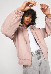 BDG Urban Outfitters - SKATE HOOD JACKET - Light jacket - pink - 5