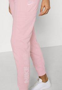 Nike Sportswear - AIR PANT - Verryttelyhousut - pink glaze - 3