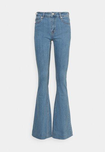 CHARLOTTE WARSZAWA - Flared Jeans - denim blue