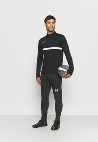 Under Armour - ACCELERATE OFF-PITCH JOGGER - Tracksuit bottoms - black/white - 1