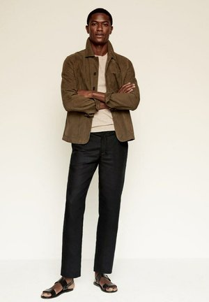 RELAXED FIT - Trousers - schwarz