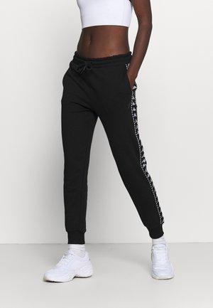 INAMA - Spodnie treningowe - caviar