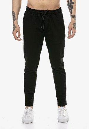 STOCKPORT - Tracksuit bottoms - black