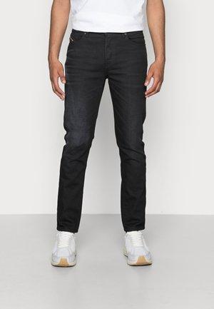 D-FINING - Jeans Tapered Fit - black denim