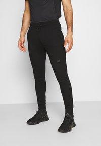 4F - Men's sweatpants - Tracksuit bottoms - black - 0