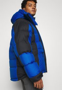 Peak Performance - POLARO JACKET - Bunda z prachového peří - artic blue - 4