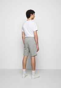 HUGO - Tracksuit bottoms - medium grey - 2