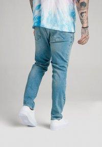 SIKSILK - STEVE AOKI X  - Slim fit jeans - light wash - 2