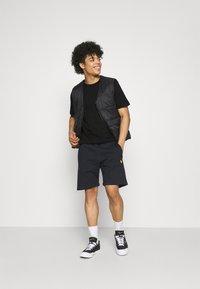 Carhartt WIP - PEACE STATE  - Print T-shirt - black / white - 1