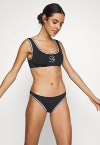 Calvin Klein Swimwear - PRIDE EDIT BRALETTE - Bikini top - black - 0