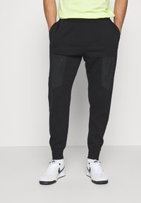Nike Sportswear - Tracksuit bottoms - black - 0