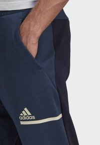 adidas Performance - Z.N.E. SPORTSWEAR PRIMEGREEN PANTS - Pantalon de survêtement - blue - 4