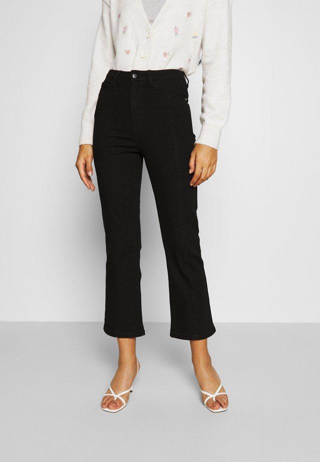 ELAINA - Flared Jeans - black rinse