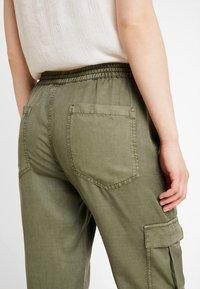 Opus - MUNDINI - Trousers - oliv green - 4