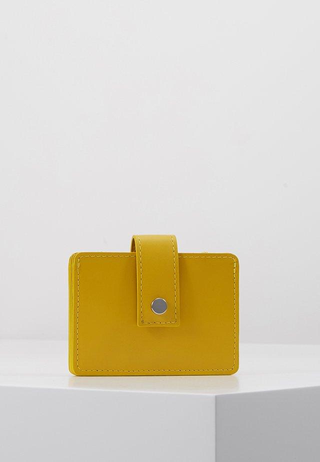 LEATHER - Portemonnee - yellow
