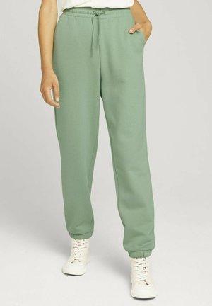 Tracksuit bottoms - light mint green