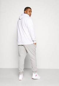 Cotton On - TRIPPY TRACKIE  - Tracksuit bottoms - peached grey marle - 2