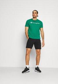 Champion - BERMUDA - Sports shorts - black - 1