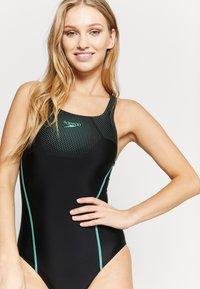 Speedo - TECH MEDALIST - Swimsuit - black/green glow - 4