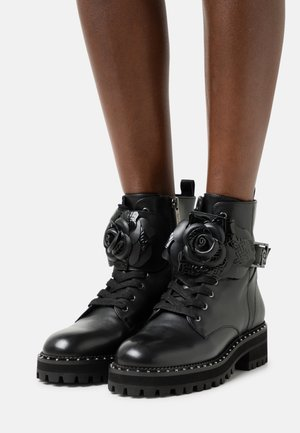 BOOTIE - Lace-up ankle boots - black