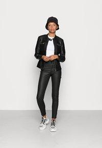 ONLY - ONLBANDIT BIKER - Faux leather jacket - black - 1