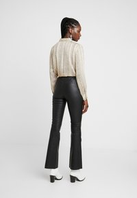 Dranella - FRUNA PANTS THEA FIT - Legíny - black