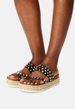 CASE - T-bar sandals - black